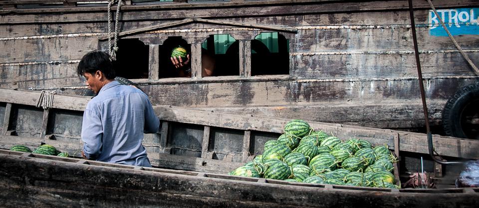Melon Vendor - Mekong River, Vietnam