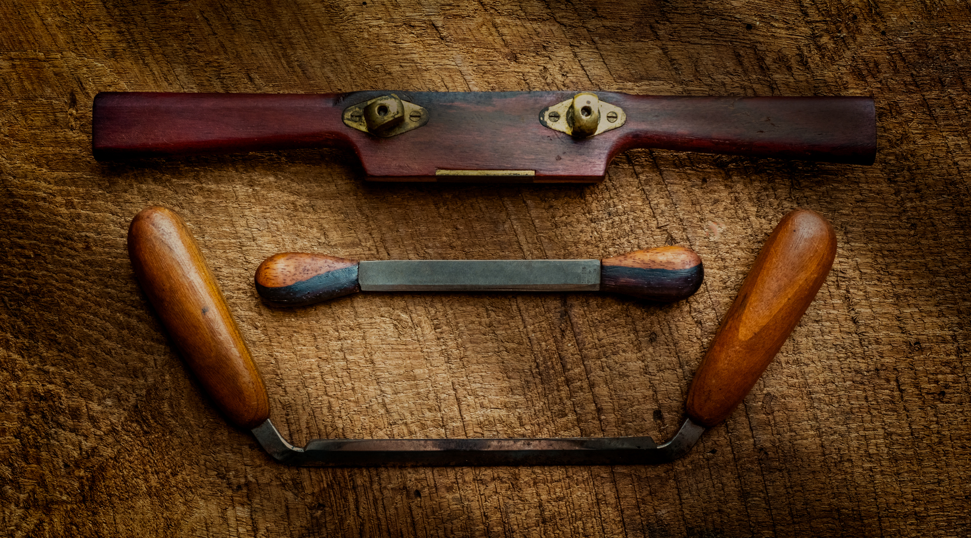Old Woodworking Tools. Two Draw Knives and a Spoke Shave