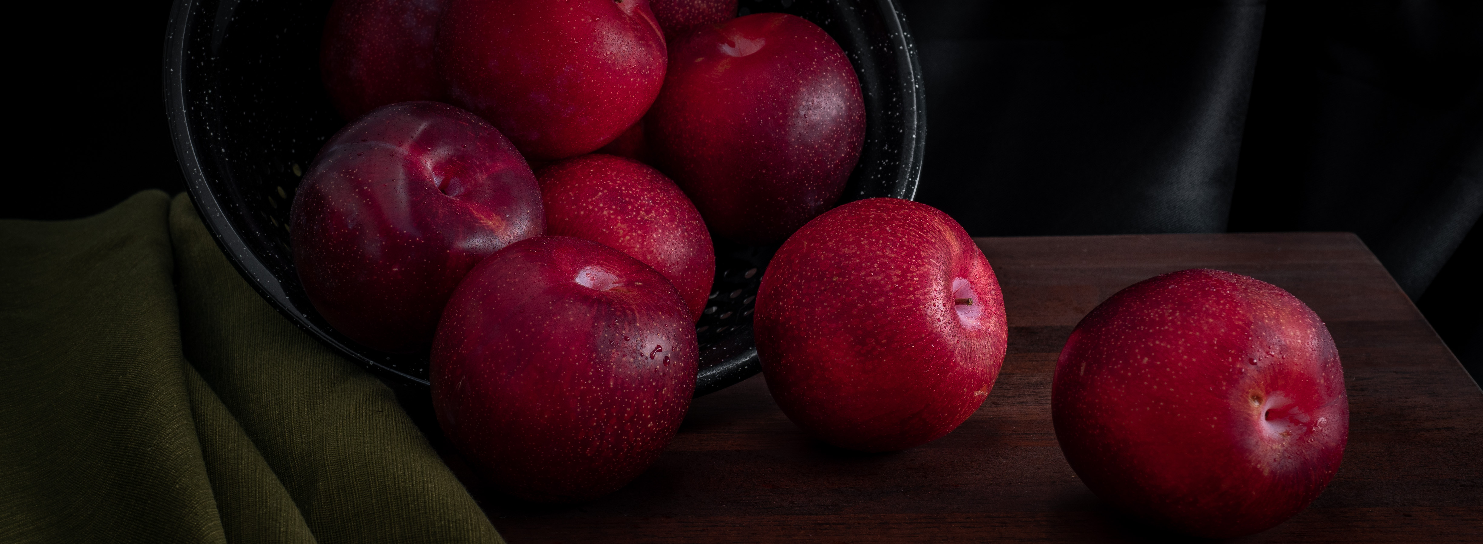 Still Life with Red Plums