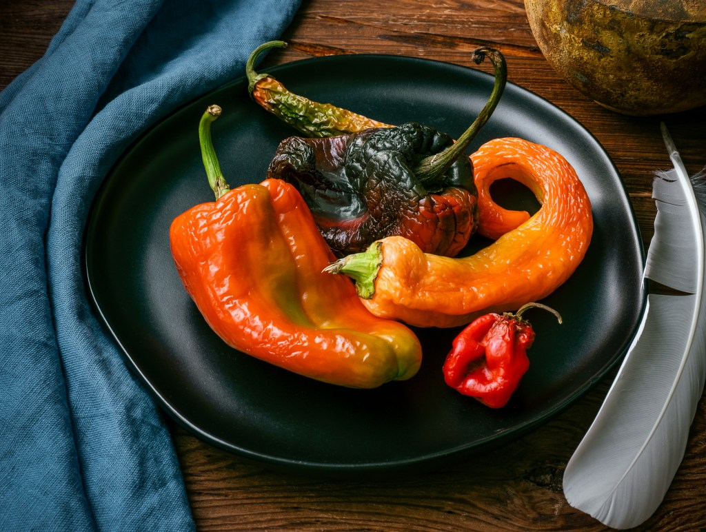 Chili Peppers and White Feather-
